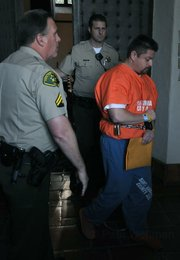 Steven Cisneros leaves the courtroom 01/11/10 to begin his sentence of 56-years-to-life in prison  for the murder of Lawrence Kaiser