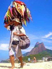 A vendedor of bikinis stalks the beach in Rio, in search of bikini-hungry customers.