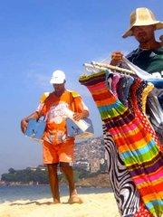 Vendedores of Matte Leão and dresses from São Paulo pace Rio's beaches.