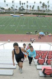 A group of Santa Ynez Valley High Schoolers work out at La Playa Stadium with Queenie Longley