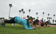 L to R Denisse Elizarraraz, Andrea Rosales, Liz Gomez, and Veronica Duran of Santa Ynez Valley High School work out at La Playa Stadium
