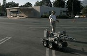 After being deployed inside the DMV the Santa Barbara Sheriff's bomb squad robot is brought back to the truck.
