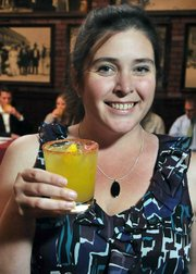 Mandy Huffaker and her mango-chili-rum 10 Cane Caliente Cooler.