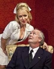 Heather Prete as Fay and David McCann as Mr. McLeavy in the Ensemble Theatre Company's upcoming production of <em>Loot</em>.