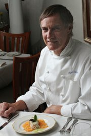John Downey with a Fresh Local Crab Salad appetizer with Tuscan melon, pine nuts and fresh ginger-lime dressing.