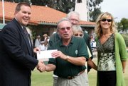 Fidelity Investments Branch Manager and Vice President Kai Bartschi handing a check for $2,500 to MacKenzie Park Lawn Bowls Club President Victor Elsey, with Pamela Polomski, Fidelity Vice President and Senior Account Executive looking on. In the back are MPLBC officers Joe Odgers and Shirley Russell.
