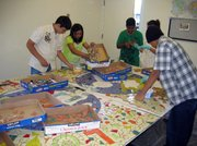 Students working on the MacKenzie Park mosaic installation.