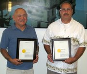 Tom Mendoza and Nick Uribe were honored recently at an MTD Board of Directors meeting for their years of service