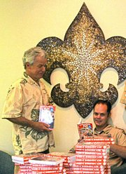 """Local author Dana E. Fisher, left, donated more than 100 copies of his book, """"Santa Barbara Fun, for Ages 1 to 100"""""""