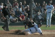 Foresters Graham Saiko tagged out sliding home in the 5th inning.