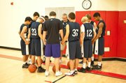 Coach Luberto and the Providence Hall team always begin practice with a word of prayer.