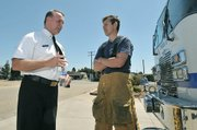 Santa Barbara County Fire Chief Michael Dyer welcomes Gilliam back to duty