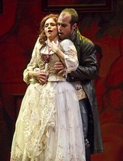 Zachary Altman as Don Giovanni interferes with Megan Hart as Donna Anna in the Music Academy's production of <em>Don Giovanni</em>.
