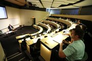 The 100 seat lecture hall in Winter features desk lamps