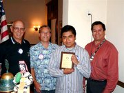 Bill Boyd, Rotary President; Michael Riley, teacher; Clemente Munoz, student of the month; and David Velarde, Rotary Member