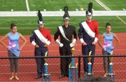 San Marcos Band Members receiving trophies at the Valencia High School Marching Band Competition in Placentia: Guard Captain Justine Sanchez, Drum Captain Molly Richardson, Drum Major Preston Nunez, Drum Captain Jackson Foster, Guard Captain Jasmine Reyes.
