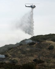 Air support fights the Glass Fire on Friday