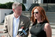 Mari Mender at the press conference held two weeks ago after two of her signs were burned.