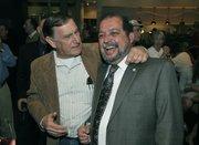 Mario Borgatello (left) congratulates Roger Aceves re-election to Goleta City Council at Hollister Brewing Co