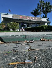 Broken glass outside of City Market in Carpinteria allegedly caused by the fleeing stabber.