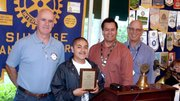 Csaba Illes, teacher; Edward Silva, Student of the Month; David Velarde, Rotary Member; Bill Boyd, Rotary President.