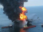 Vessels combat the fire on the Deepwater Horizon while the United States Coast Guard searches for missing crew
