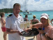 Sue De Lapa reaches for the bubbly at a Sea Dream cruise beach party.