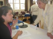 Gabriela Rodriquez of Future Leaders of America discusses Assembly Bill 540 with longtime league member Betty Newcomb during Wednesday's forum.