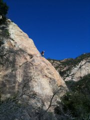 SAR team member lead climbing to first subject to secure him into a rope system for lowering