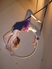 Helen Dickson performed on the lyra, a metal hoop hanging from the ceiling, during La Petite Chouette's recent showcase.