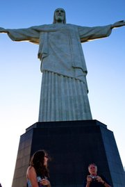 My sister poses while my dad struggles with the camera at the no.1 tourist attraction in Rio de Janeiro, Cristo Redentor (Christ the Redeemer).