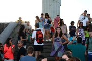 My sister poses at the feet of Christ, surrounded by a few of Cristo Redentor's some 30,000 annual visitors.