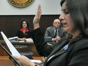 Helene Schneider and Grant House watch as City Clerk Cynthia M. Rodriguez swears in Randy Rowse to the City Council. Dec. 14, 2010