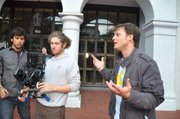 Brent Rumble, left, directs the shooting on State Street.