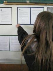 Sydney Eads showing off Bolivia information boards