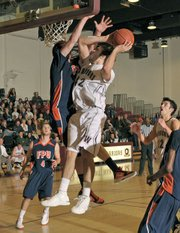Westmont's Dan Rasp (#42) went for the basket in the Warriors' game against Fresno Pacific at the GSAC Tournament.