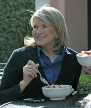 Martha Stewart smiles for a fan's camera while visiting Epic Bowl