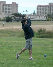 <strong>LAST ROUND?:</strong>  Daniel, a senior at UCSB, gets in a quick nine holes at Ocean Meadows Golf Course in Goleta earlier this week. Plans are in the works for the links to soon be sold to the Trust for Public Land and eventually turned back into the Devereux Creek wetland area it once was.