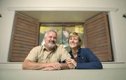 """Doug and Marian McKenzie at home in Montecito framed by a window curtained from Bettina Hubby's """"Hubby Moves In."""""""