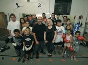 A small group working out at the Primo Boxing Club on a Monday afternoon step in the ring for a photo.