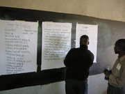 Heads of local schools brainstorming about a plan of action for funding pressing school projects.