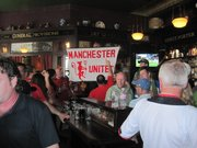The pubs of Seattle were teeming with Manchester United supporters.