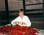 Betty Williams eating crawfish the traditional way in the bayou in Louisiana.