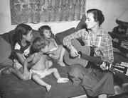 Betty Williams singing folk songs to the 3 children, Barry, Toby and Seyburn, early 50's.