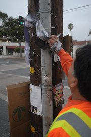 "<strong>STREET FIGHTERS:</strong>  The City of Santa Barbara' graffiti abatement ""crew"" —  using nontoxic chemicals to remove tags on power poles and elsewhere. ""It's gotten way worse,"" said the one full-timer, Mike Borrayo. ""It's pretty much doubled."""