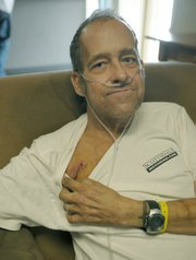 """William """"Kickstand"""" Armstrong shows off the scar from his pacemaker surgery."""