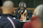 Babatunde Folayemi speaks at a Pueblo sponsored forum discussing a gang injunction on Oct. 20, 2011