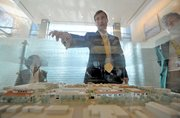 Nathan Sigler, Director of Transition Planning, at a model of the hospital