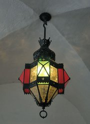 One of the original 1931 lamps hanging above the Arlington Theatre's front doors