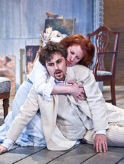 Charles Pasternak (right) and Dee Ann Newkirk play husband and wife in this updated version of August Strindberg's classic 1889 play.